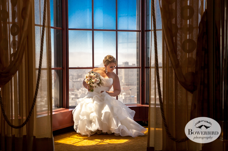The bride with view of San Francisco cityscape behind her. Westin St. Francis © 2014 Bowerbird Photography
