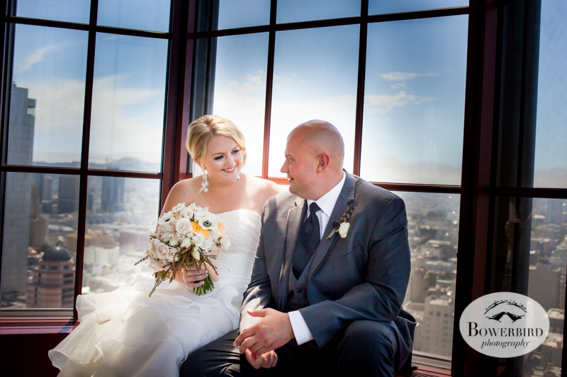 The bride and groom take a break on the window sill at Alexandra's, Westin St. Francis © 2014 Bowerbird Photography