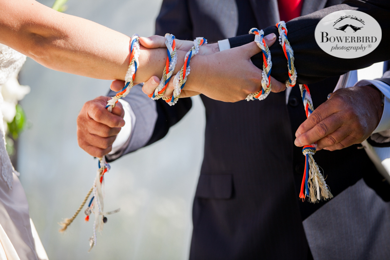 Traditional Celtic handfasting during the bride and groom's wedding ceremony at DeLoach Vineyards. Sonoma Wedding Photographer. © Bowerbird Photography 2016