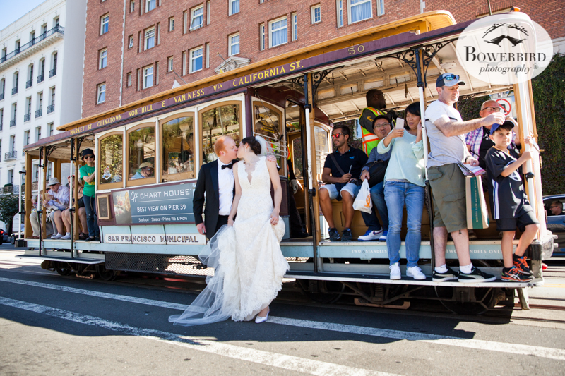 The couple kiss in front of San Francisco's iconic cable cars. © Bowerbird Photography 2016
