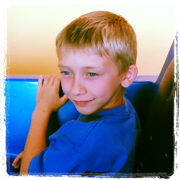 May 2012: KOA/SheCon trip - Matt on the People Mover at Disney World