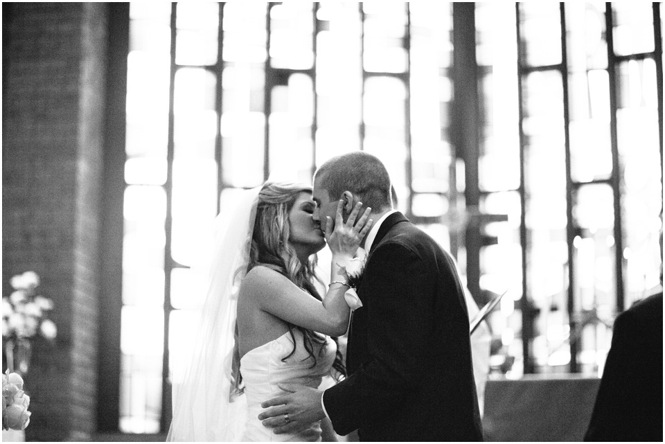 The Kiss! Cleveland Wedding Photographer Windows on the River