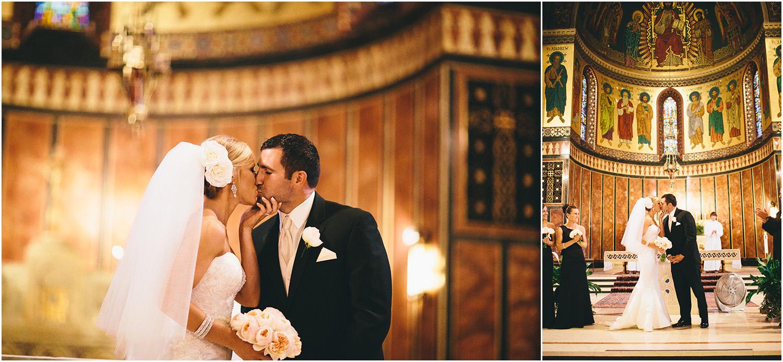 A beautiful kiss! - Creative Cleveland Wedding Photographer - St. James Church
