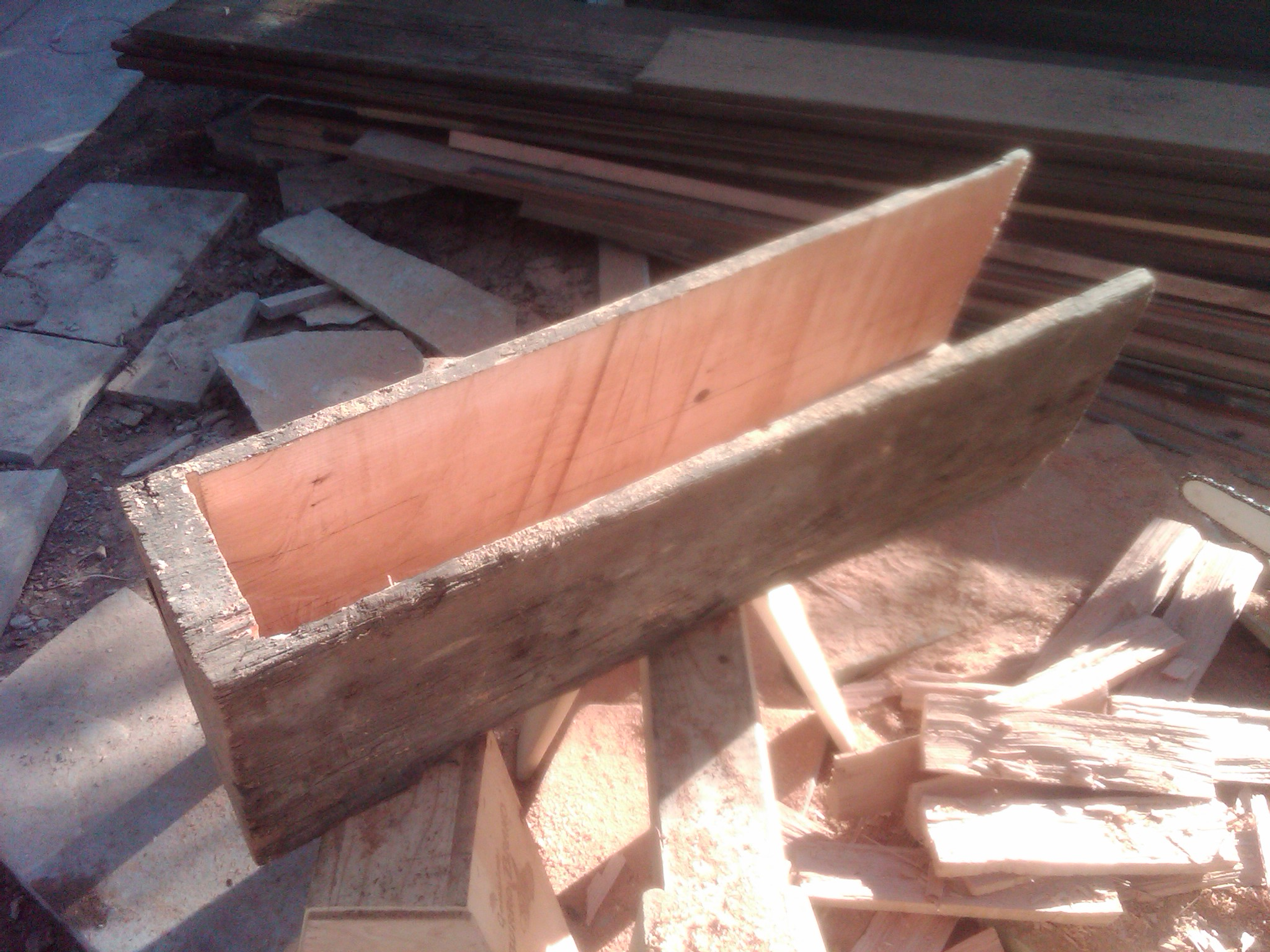 An old beam carved out to fit over the structural beam