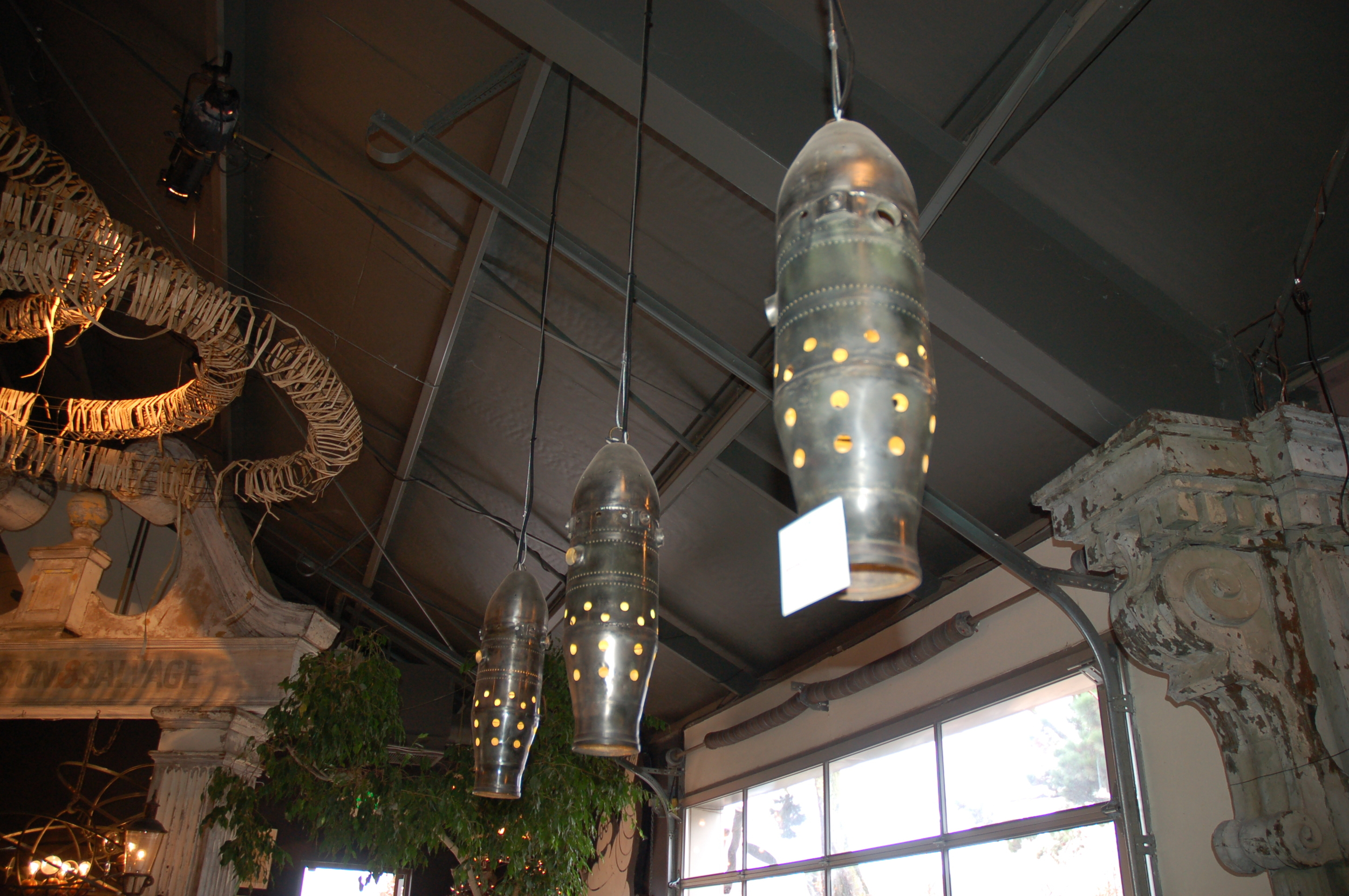 On a trip to Sonoma, I found these perfect light fixtures at  Artefact Design & Salvage . These were crafted from old jet engine parts.