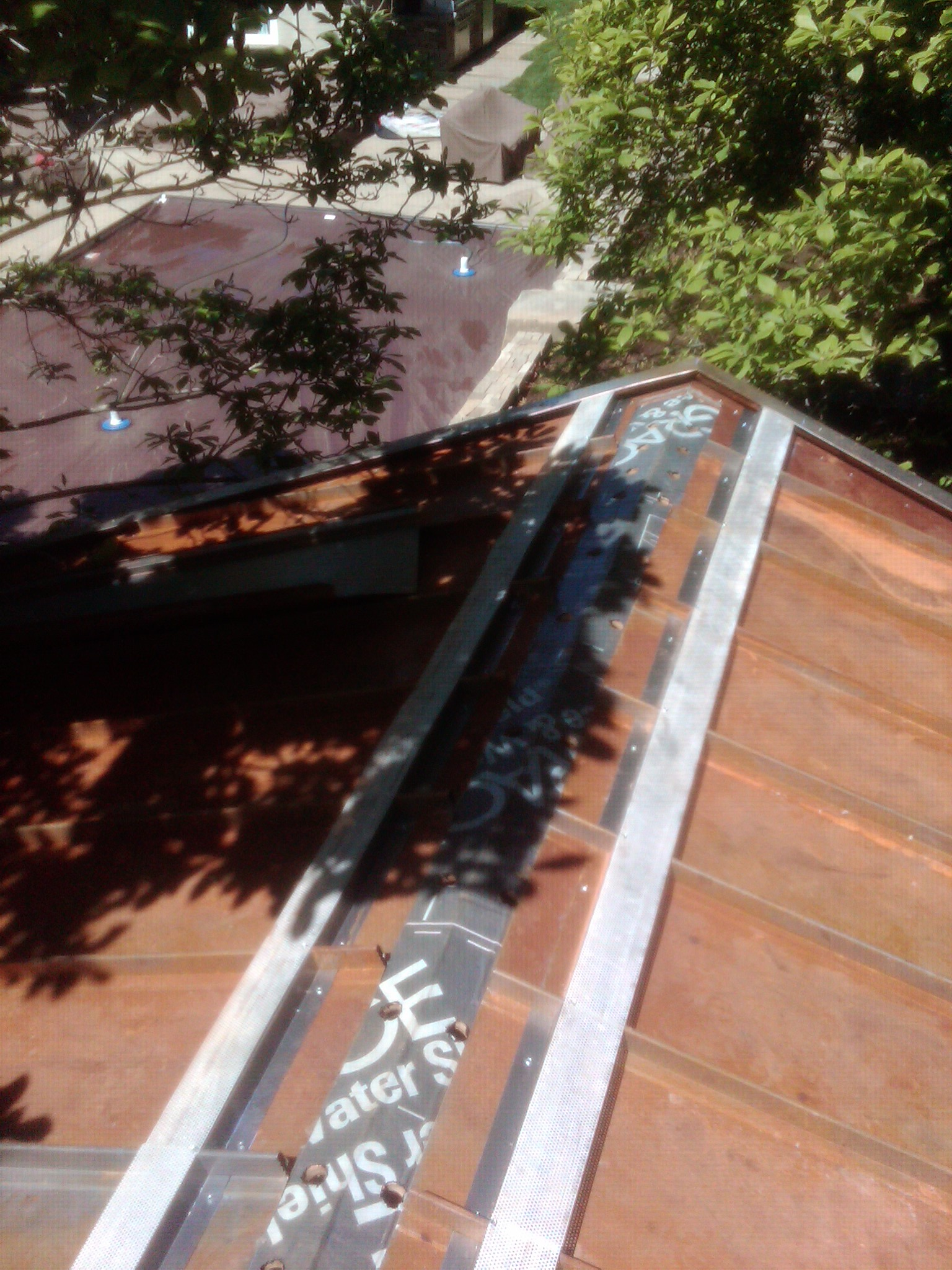 Corten steel roofing going on. Corten is designed to weather in place, and the resulting rust creates a natural protection for the steel