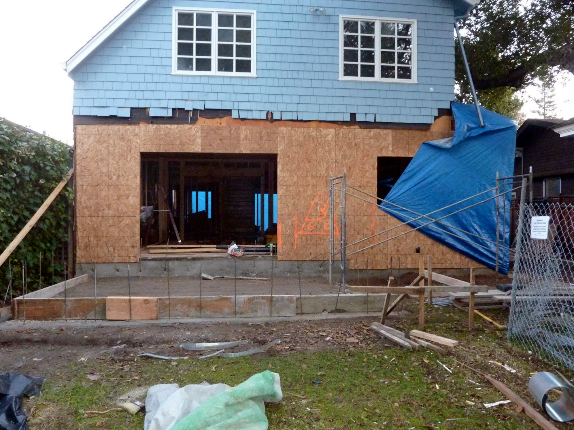 Rear wall of Family Room and Kitchen with the new foundation for the rear porch
