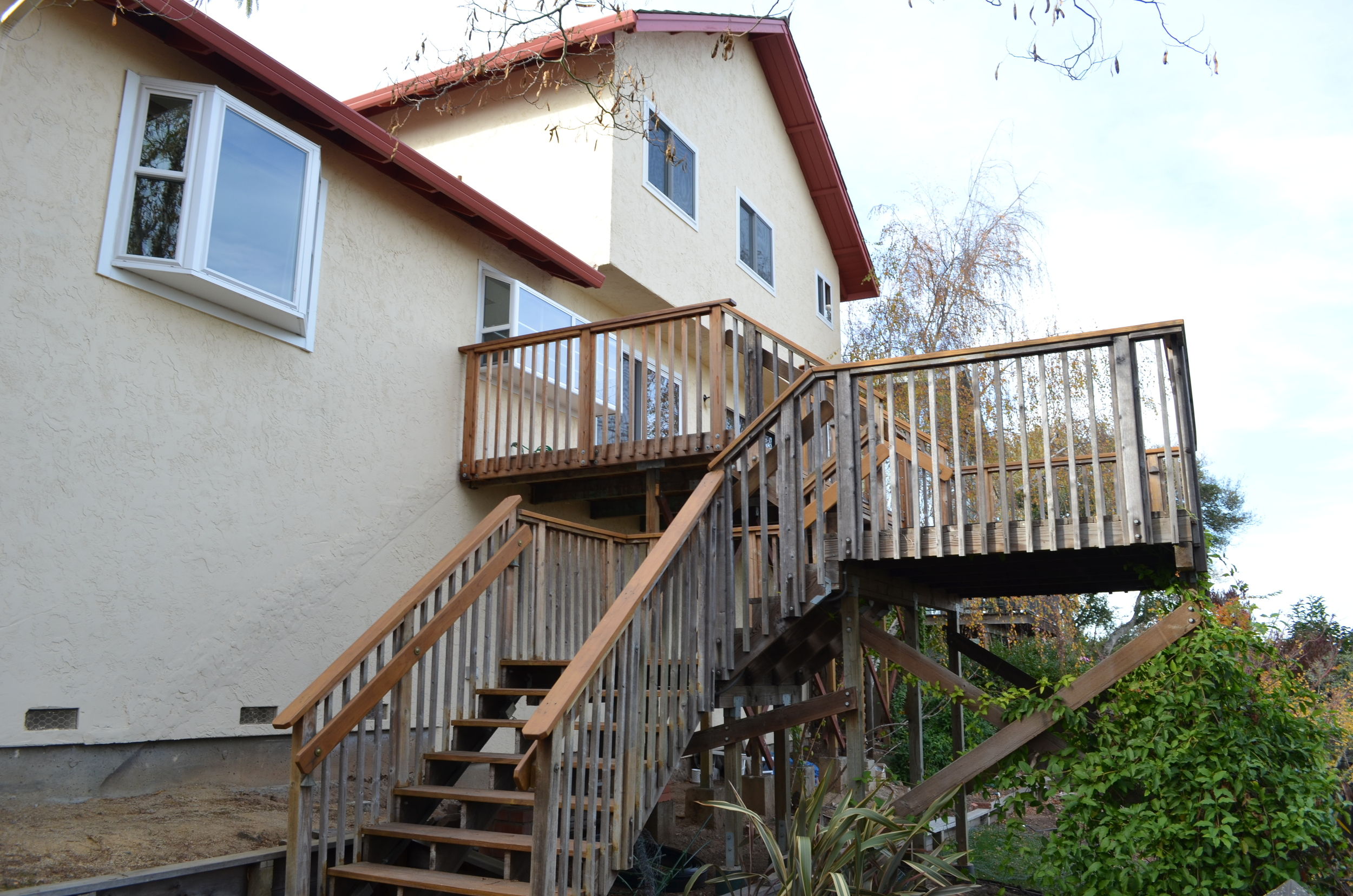 The deck and rear of the existing house.