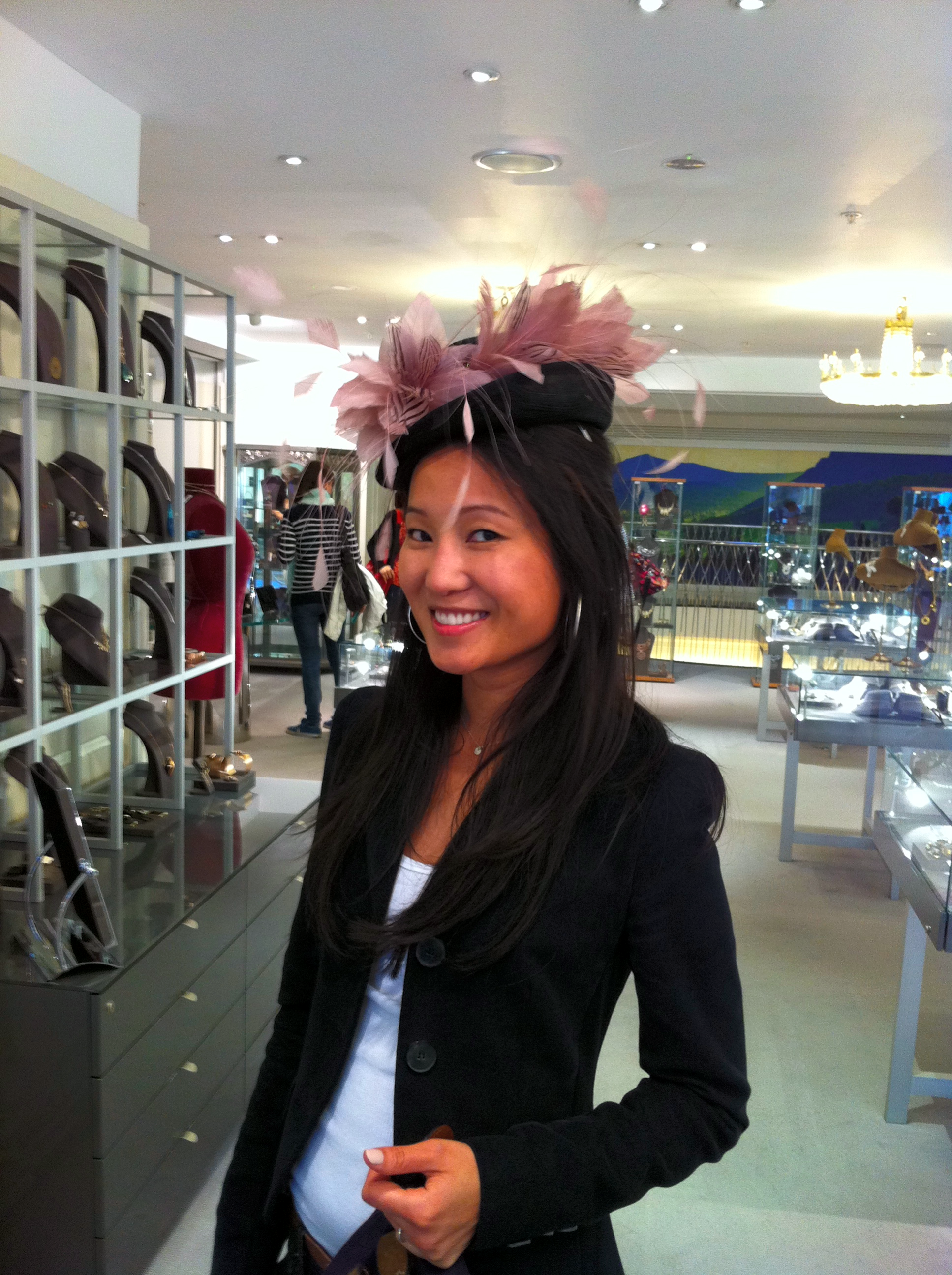 Trying on hats at Fortnum & Mason