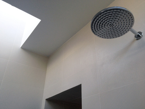 modern shower room with skylight and rainshower