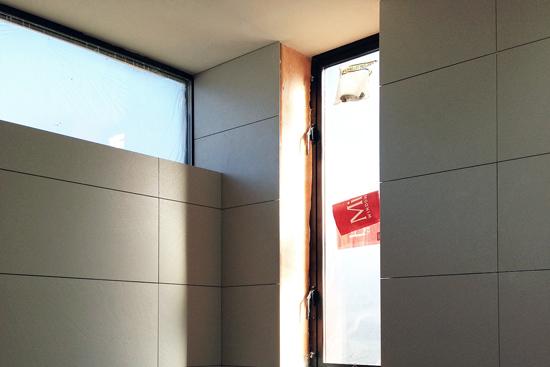 custom modern bathroom construction - rectified tile installation
