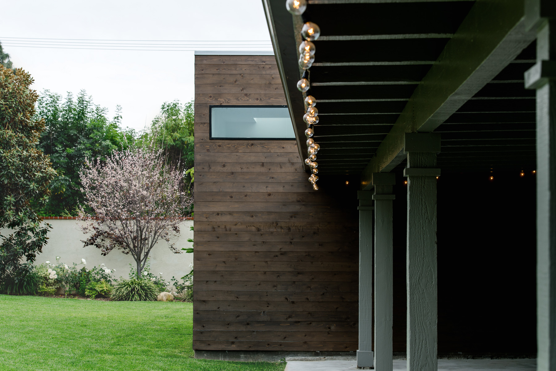 cedar-clad addition at rear