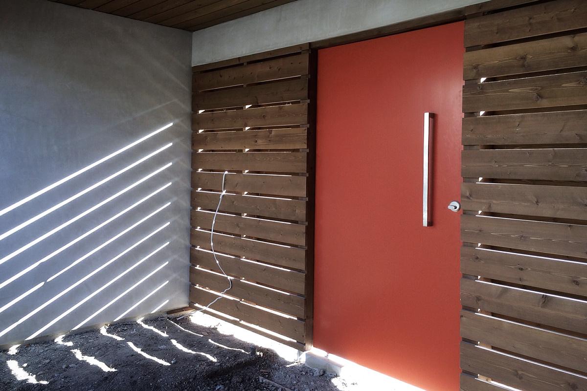 orange pivot gate / entry courtyard