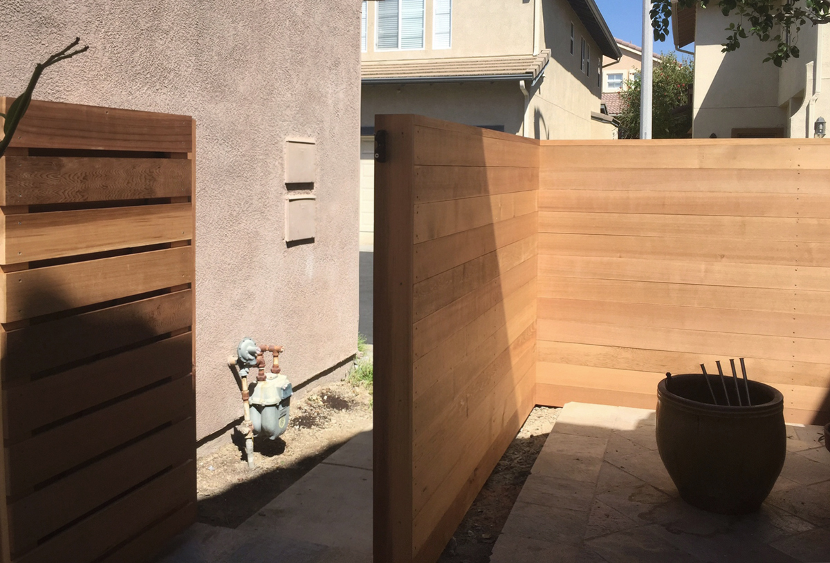 double-sided fence at exterior kitchen location