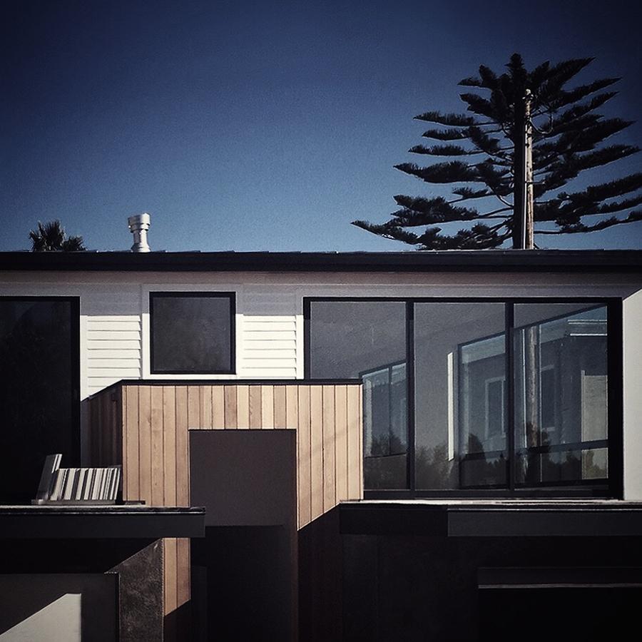vertical cedar + white siding / front entry