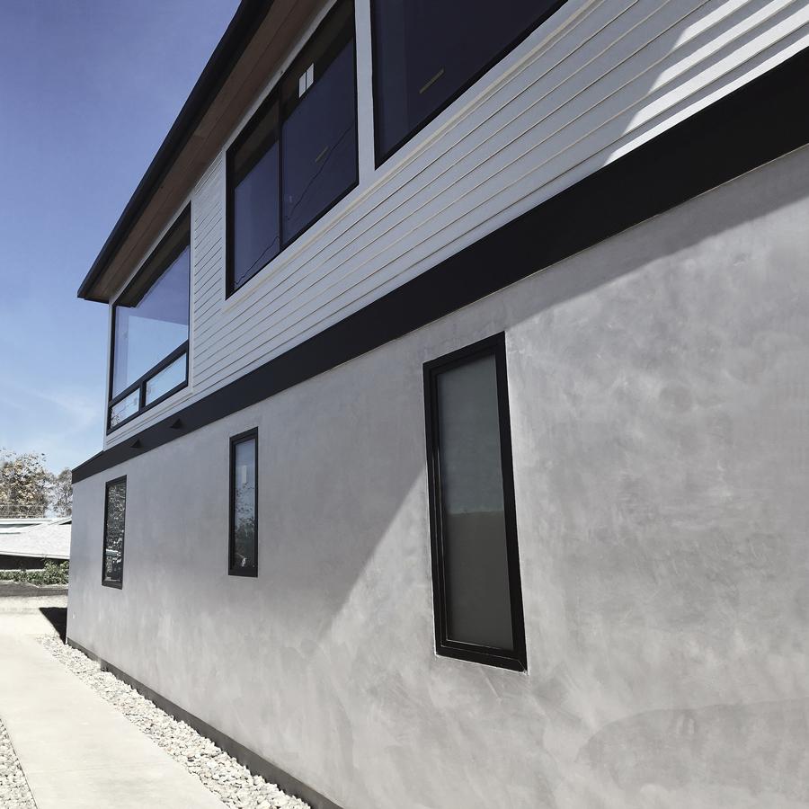 stucco + siding / sideyard