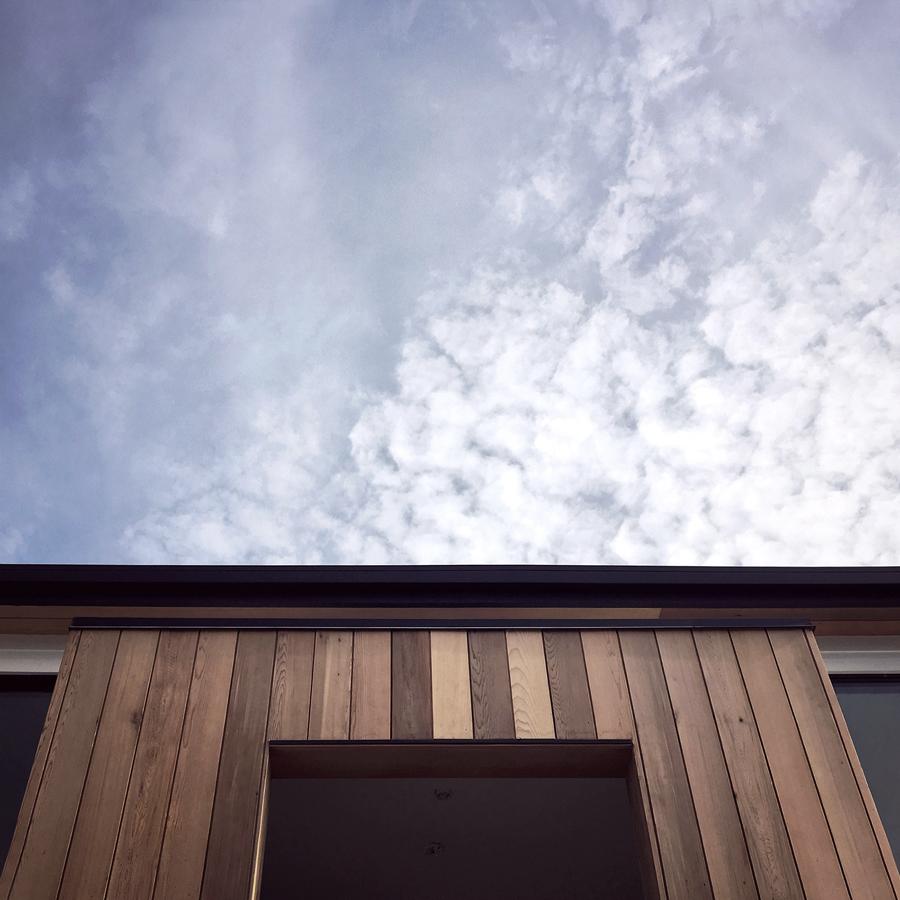 vertical cedar at entry / fern street cottage construction, lagu