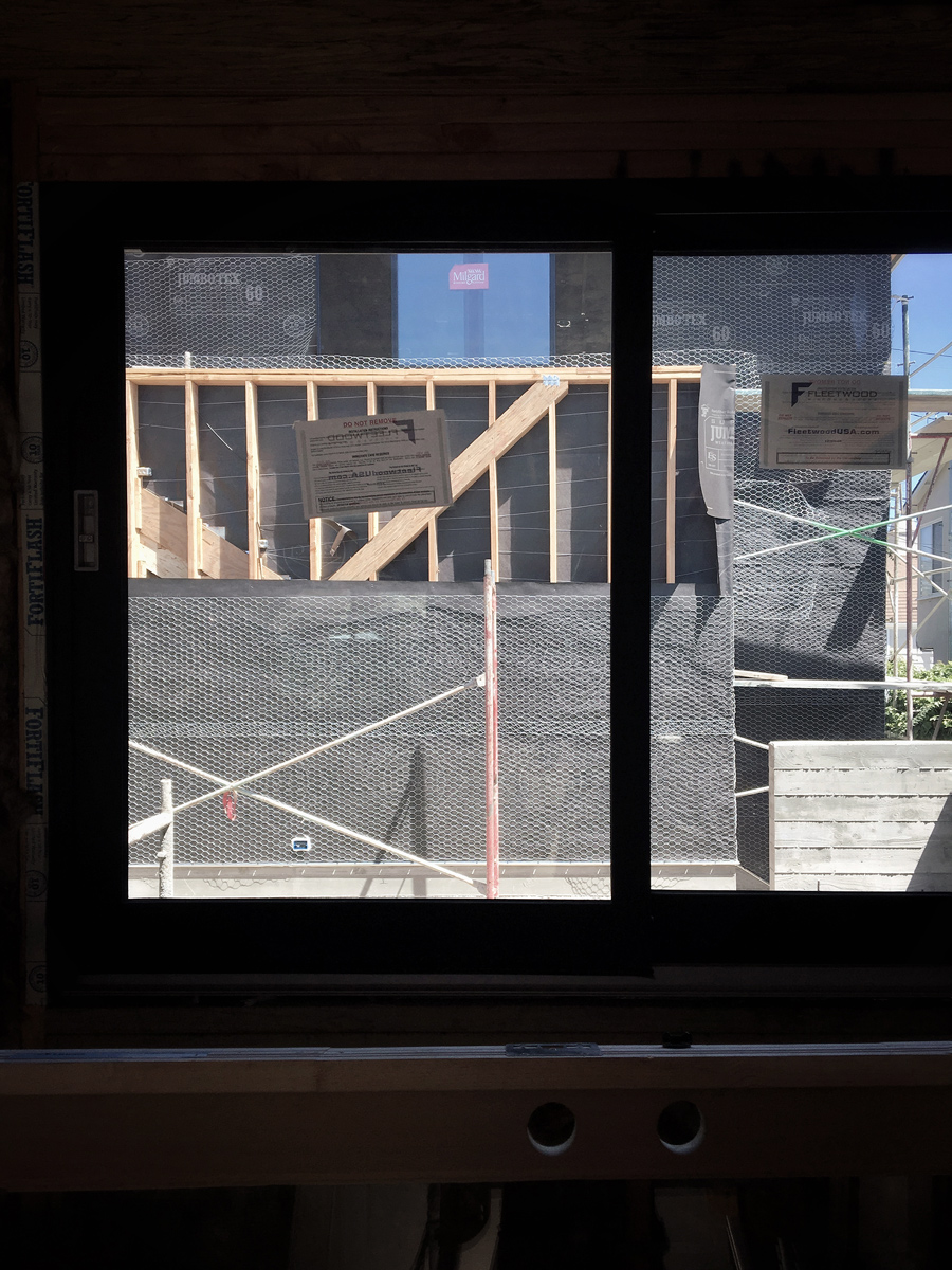 multislide window system at kitchen pass-thru