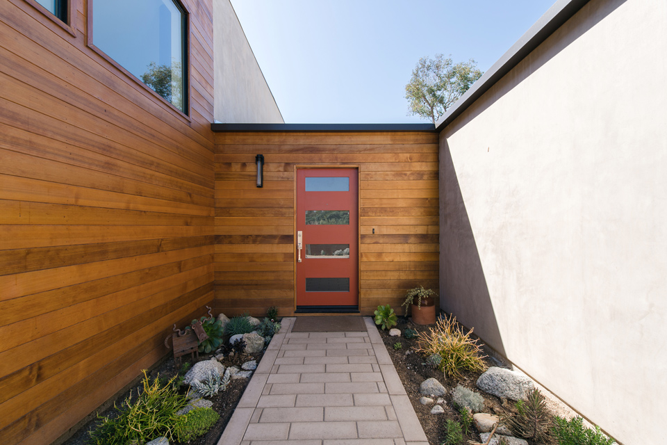 clear cedar + smooth stucco at entry