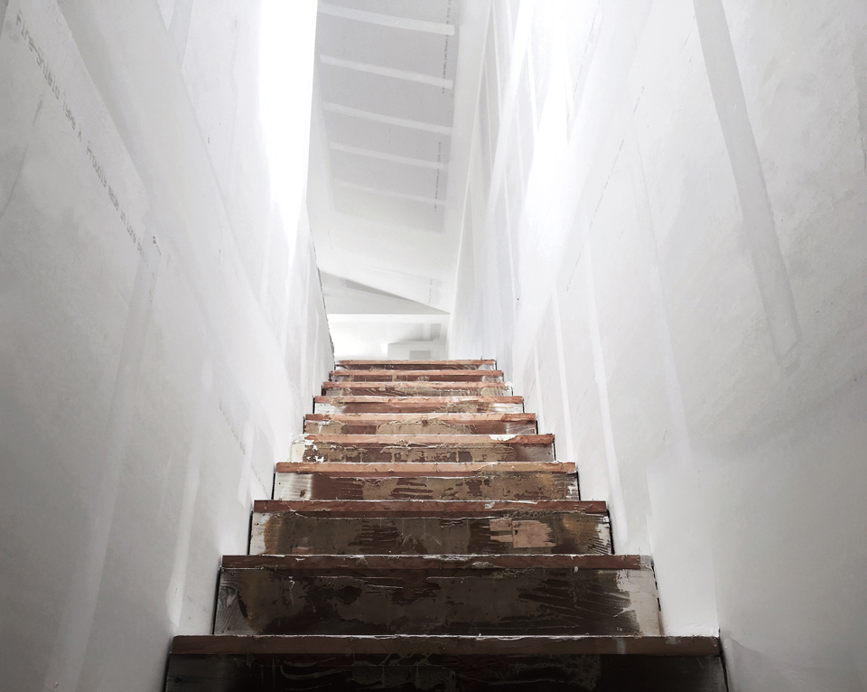 interior symmetry / drywall at stair