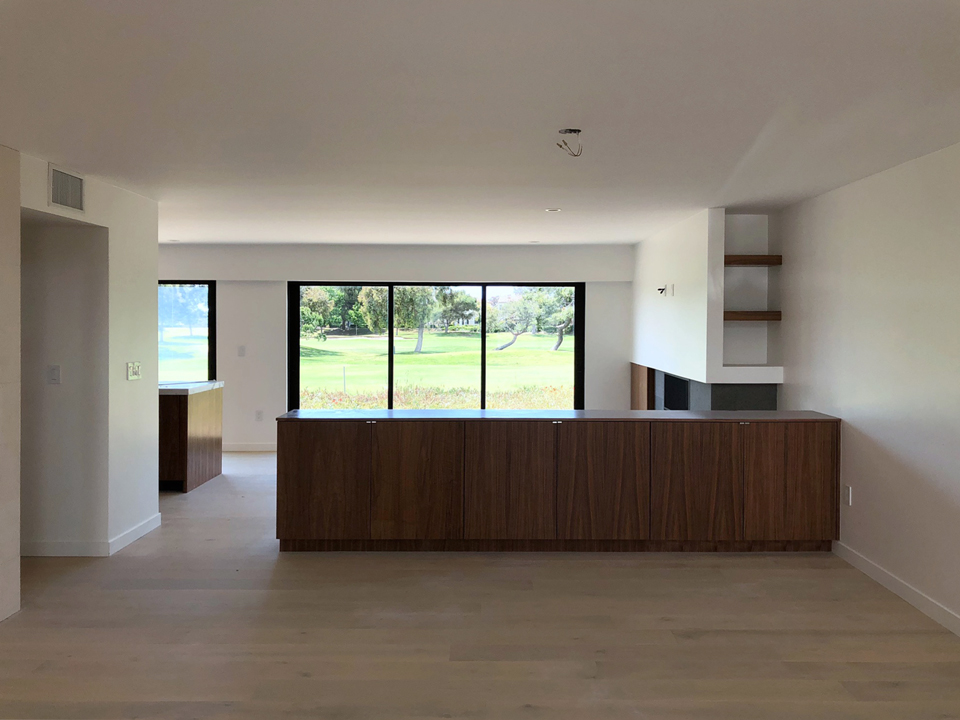 built-in cabinetry at open dining room / view from entry