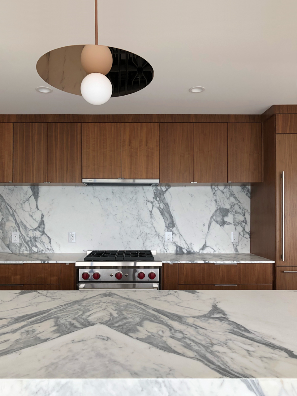 walnut, bookmatched marble + rose gold / kitchen island detail