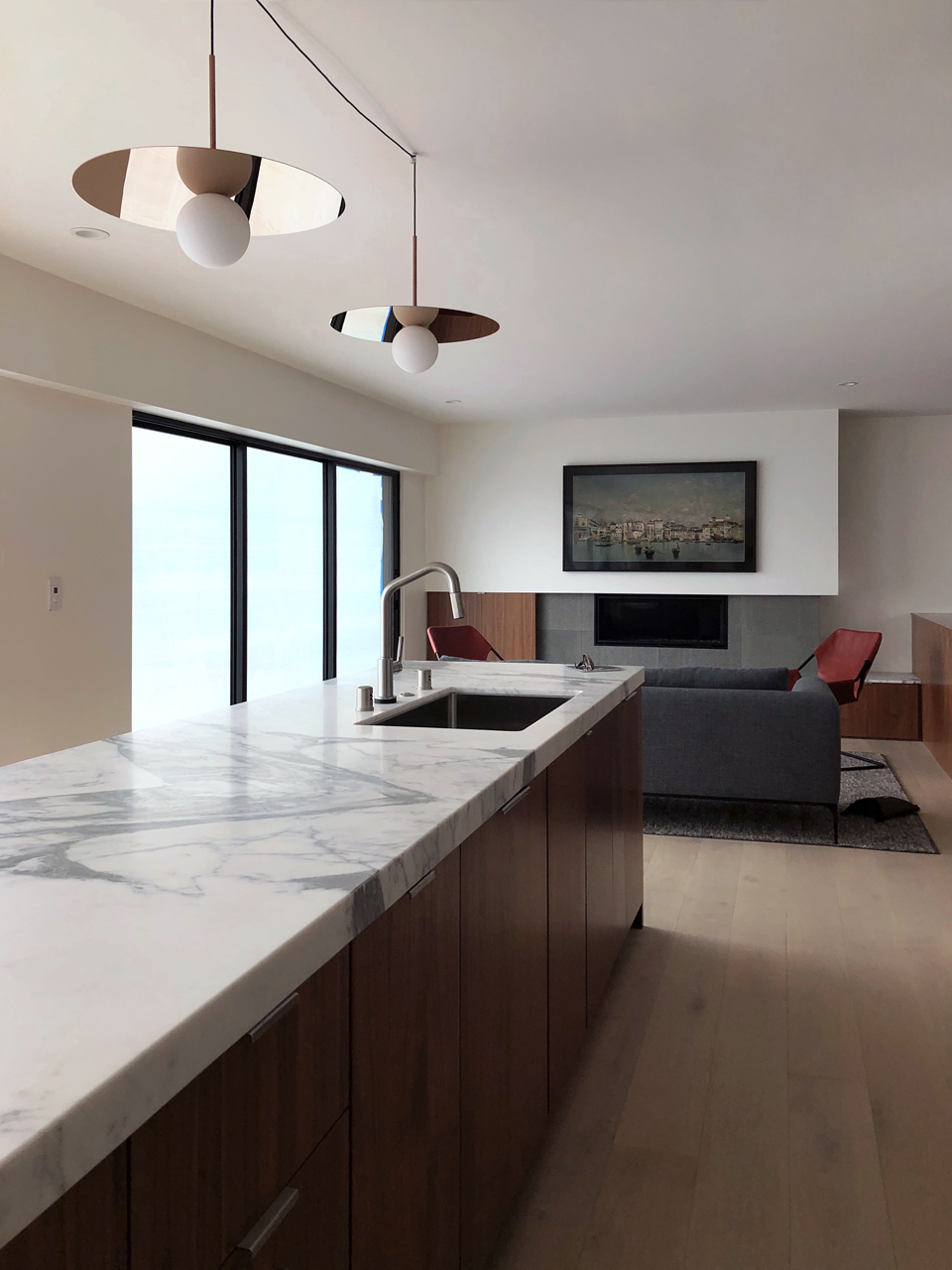 calacatta marble at island / open kitchen at family room