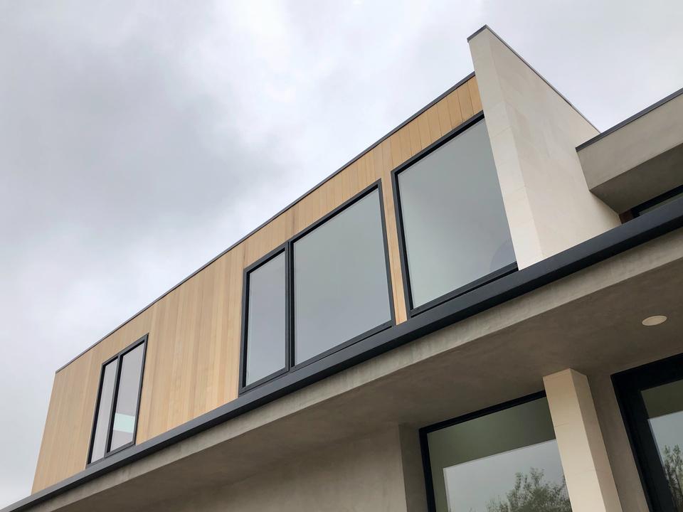 vertical cedar at front addition / exterior facade