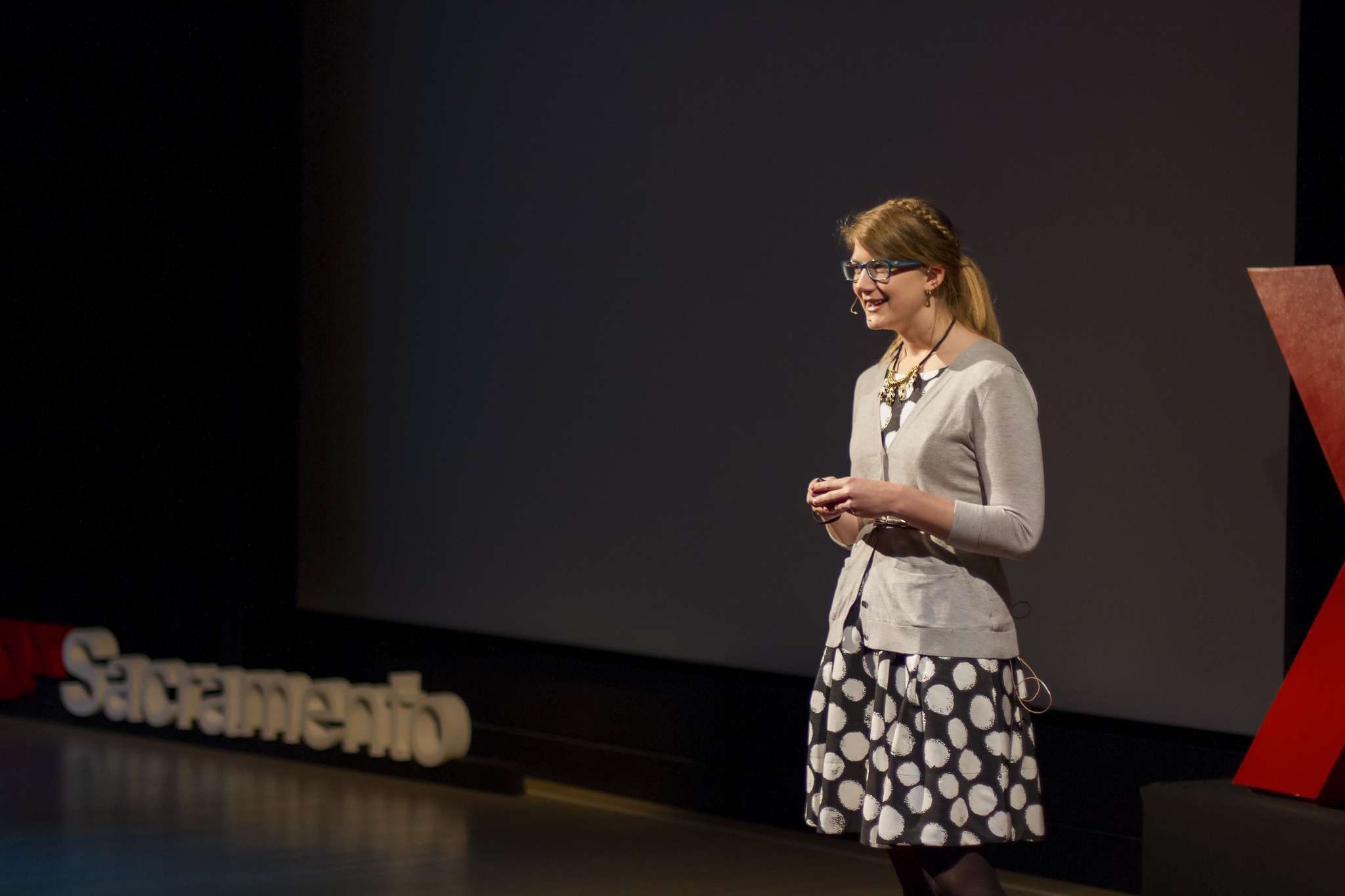 Emily Graslie, Chief Curiosity Correspondent for the Field Museum, speaking on the TEDxSacramento stage.