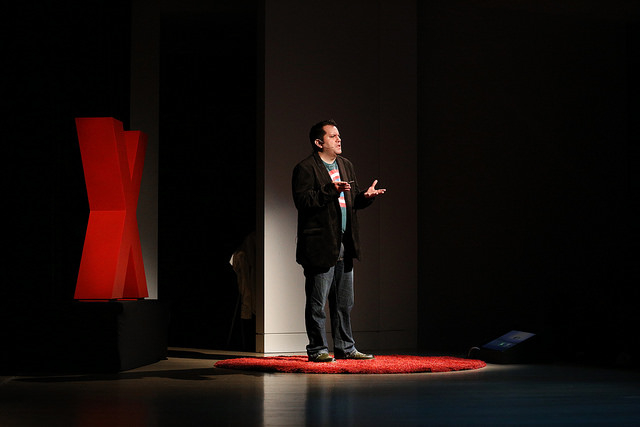 "John Marcotte speaking on the TEDxSacramento stage at  ""This Changes Everything: WOMEN"" in December 2014."