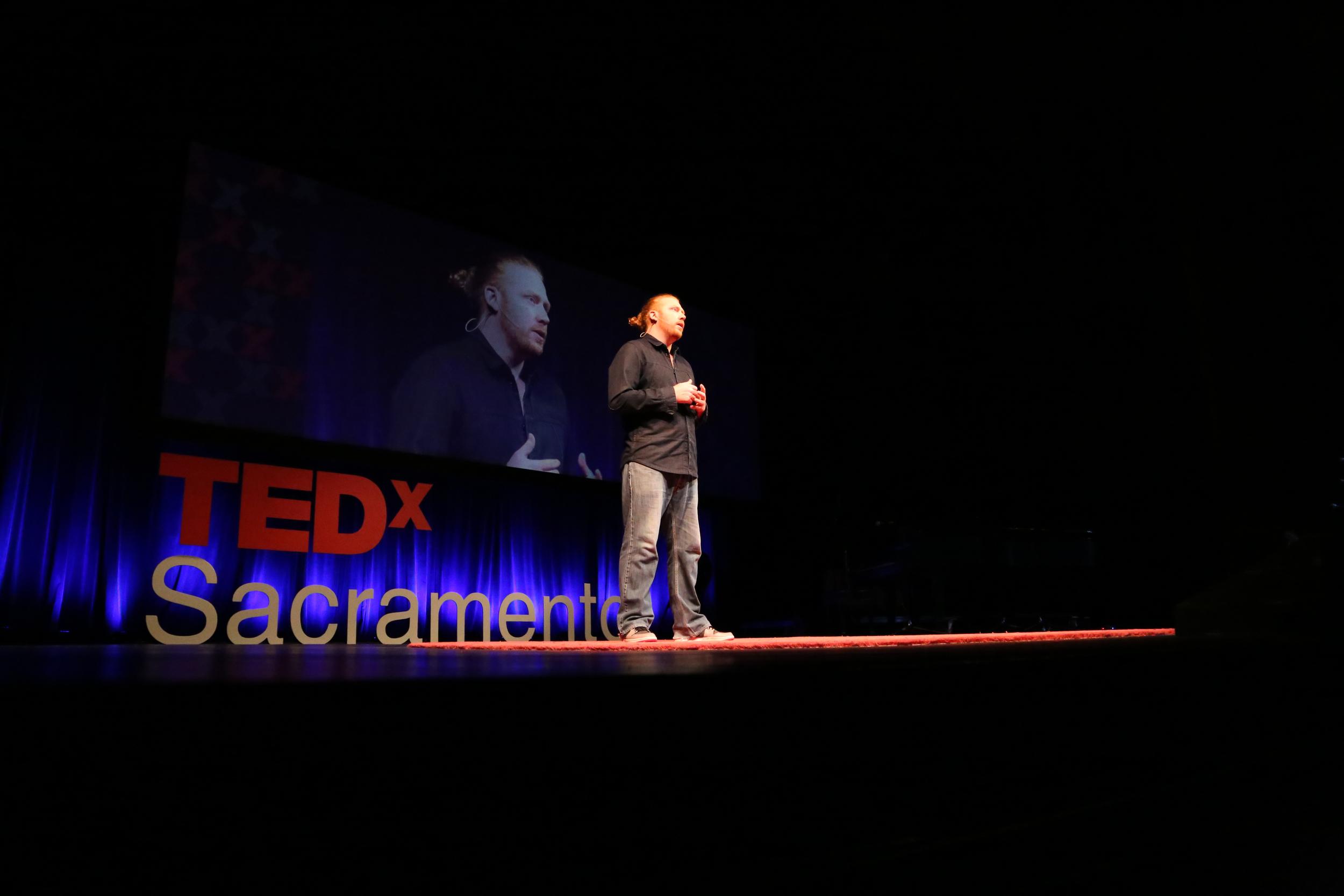 TEDxSacramento speaker Alexander Dervin on the TEDxSacramento stage. Photo: Phil America.