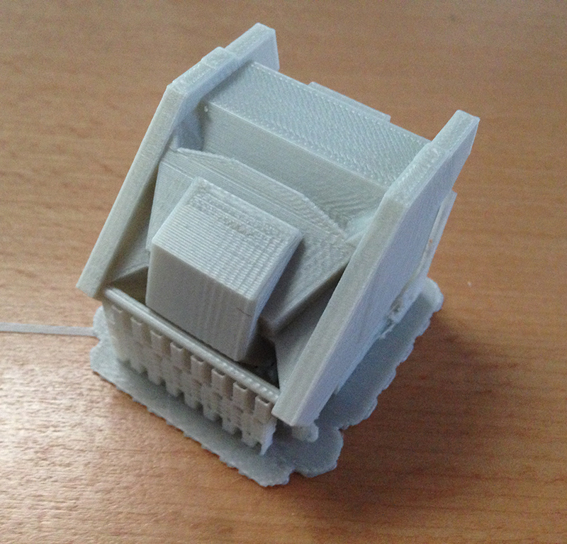 Somehow - between running the geometry through cloud.netfabb.com, repositioning model and uninstalling makerware we finally got a chest block to print out correctly.
