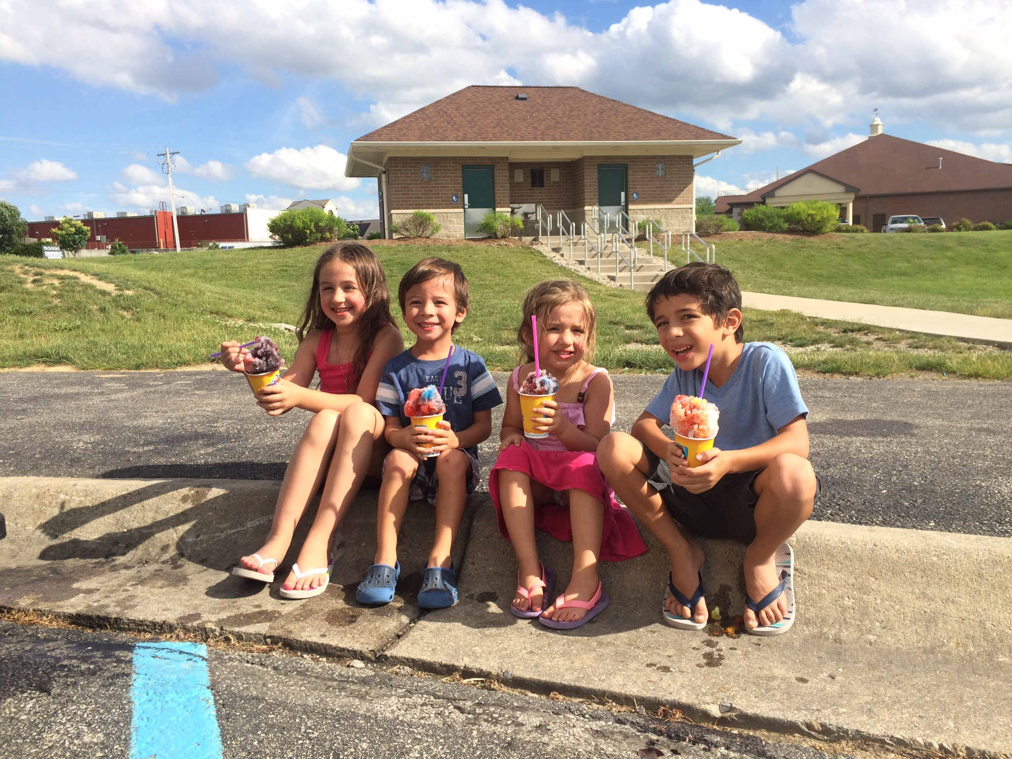 Taylor, Noah, Jordy and Koa eating shaved ice after playing in the park