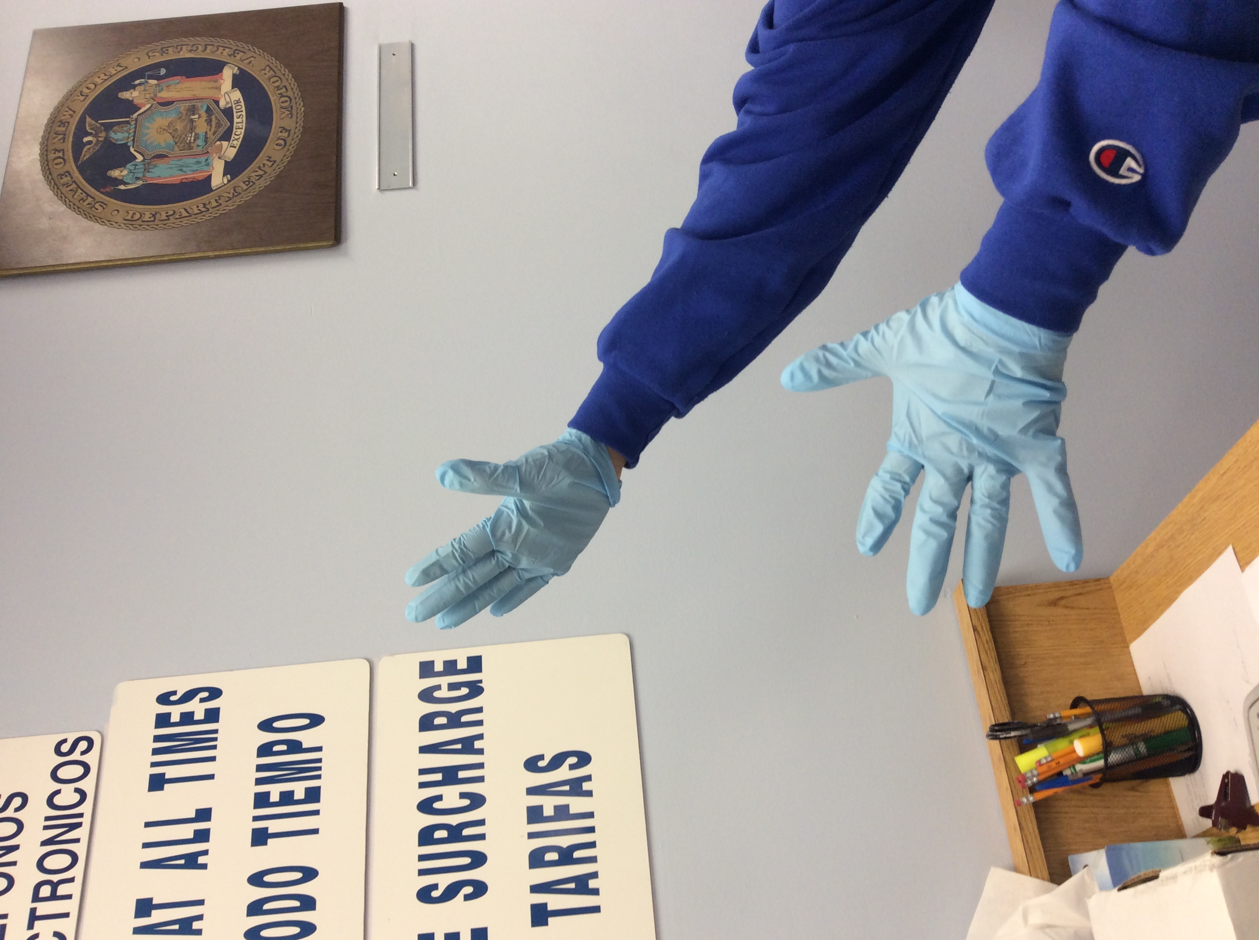 Clerks wearing latex blue gloves as a precaution after motorist claimed to be sick and from Africa.