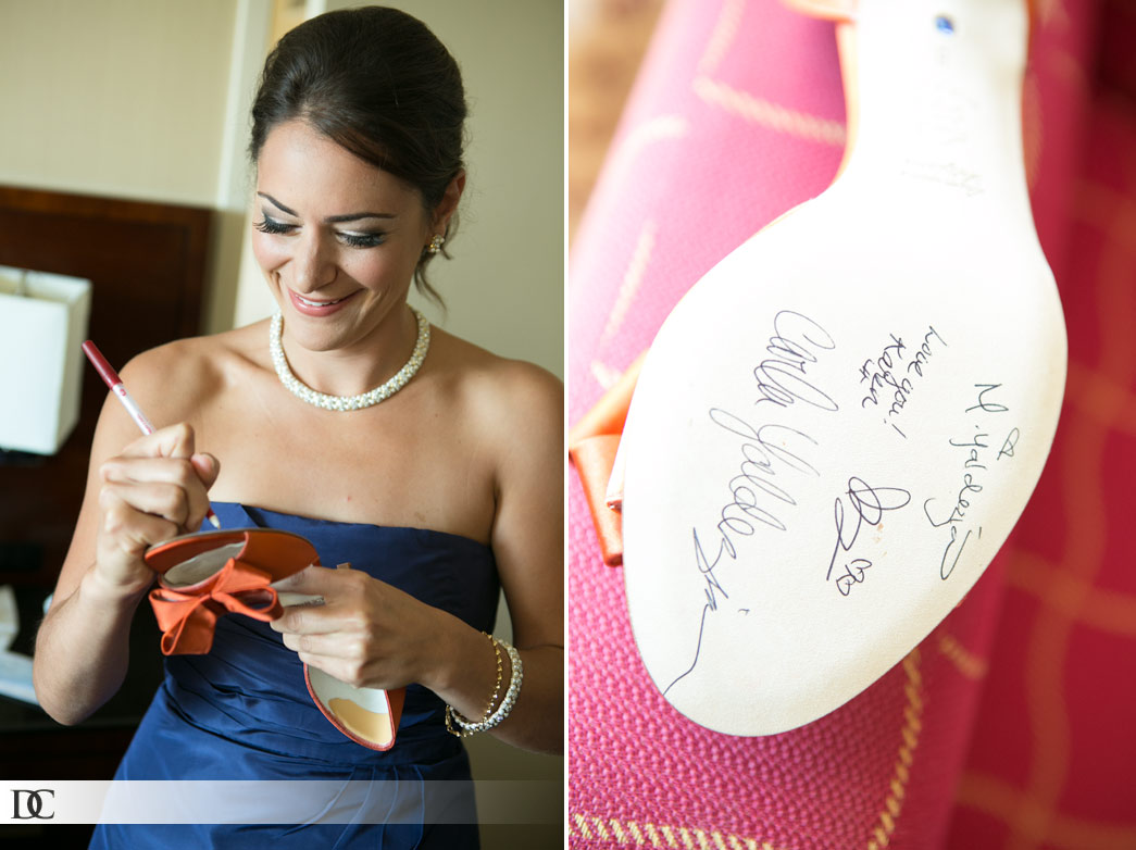 The bridesmaids all signed the bottom of Lauren's shoe as part of a family tradition.