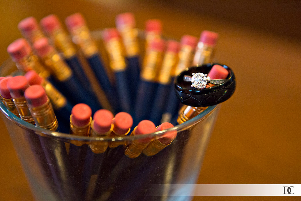Since the wedding was held at a golf course, these golf pencils were the perfect setting for a ring shot.