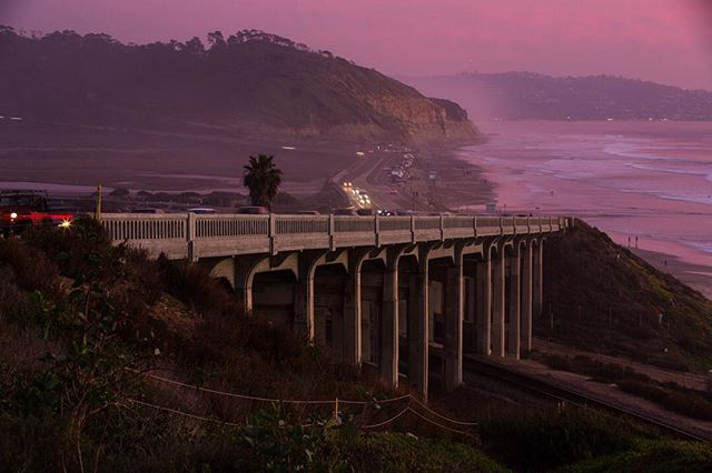 I couldn't bear to square-crop this sweeping shot of one of the most iconic scenes in my hometown of #sandiego. The last colors of late December daylight hush over #torreypines. I wanted to compress the view of the excellent architecture of the bridge against the cliffs, so I used a 105mm focal length. ISO100 f11 .6sec #canon #canon5dmarkiii #nightphotography #beachlife #purple