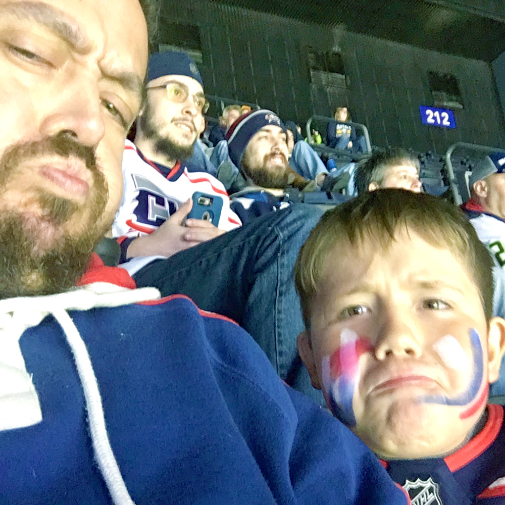 Being silly in the stands in the first period.