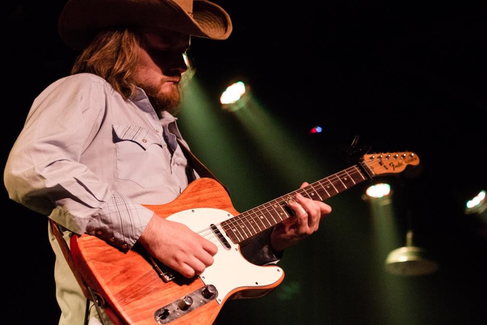 Guitarist Laur Joamets earning his choice of headwear
