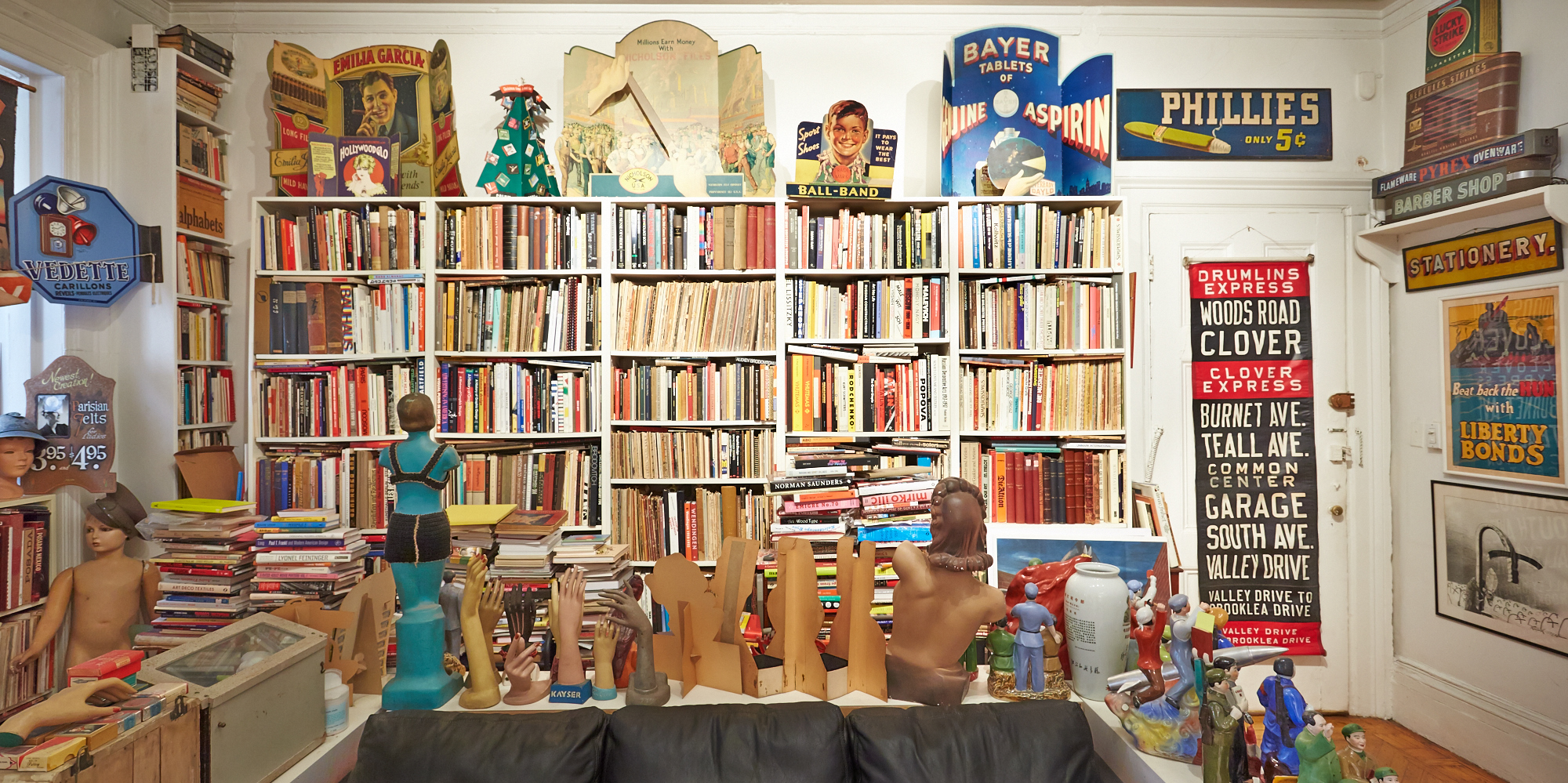 "Books not authored by Steve. He sometimes refers to his studio as ""The Cave,"" perhaps because of the  stacks of books growing up from the floor like stalagmites. (Click on photo to enlarge)"