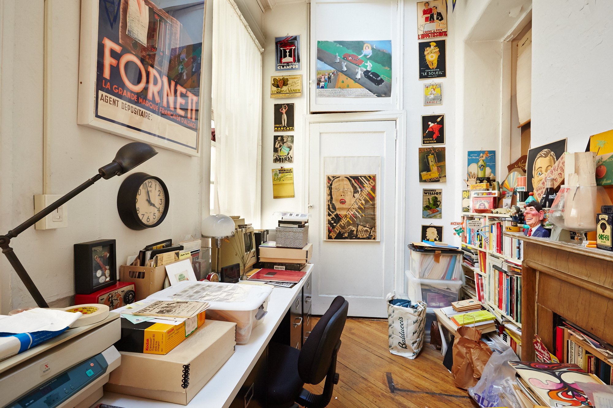 Steve's desk surrounded by reference material and inspiration. The closet at the end of this room is full of Carousel slide trays. (Click on photo to enlarge)