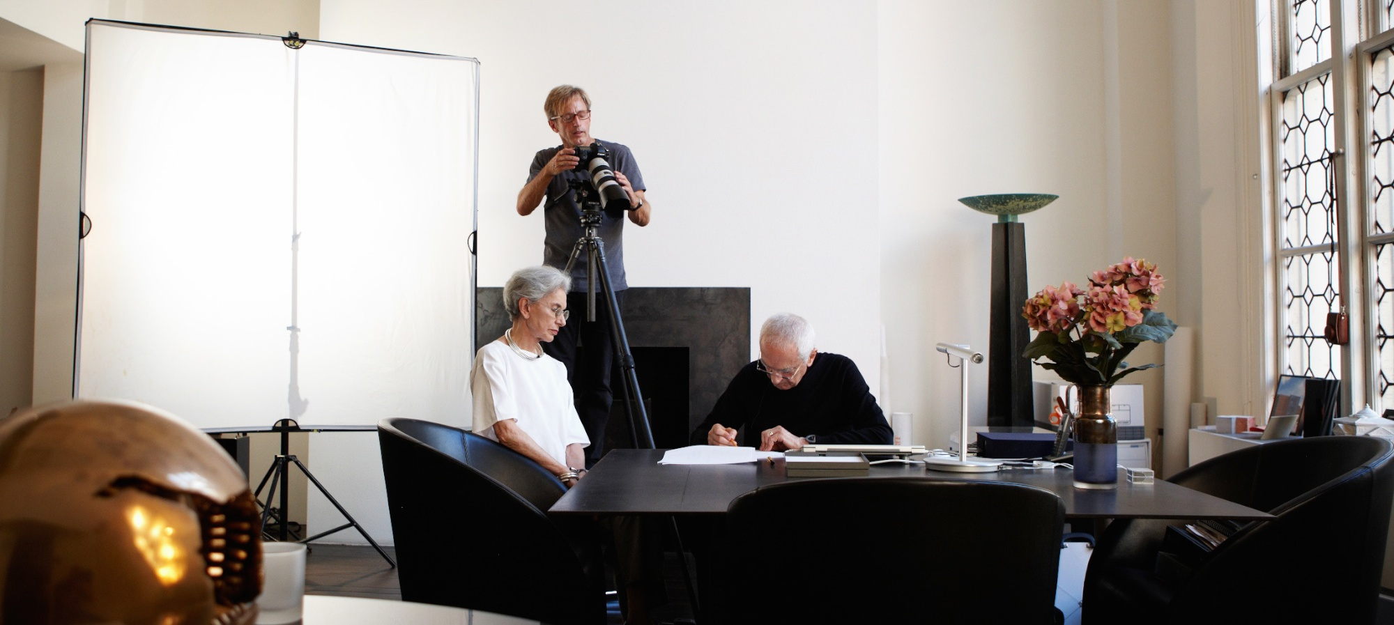 John Madere filming Massimo and Lella as Massimo sketches images of the Vignelli Center for Design Studies interior