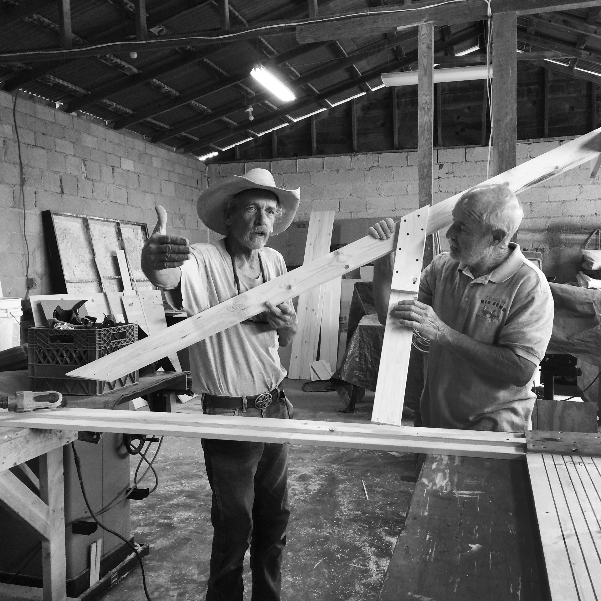 Matt Campbell, Alpine's resident master set builder and 2nd unit producer Mike McShane go over assembly details for the pine frame used for DJ's portrait. The ten foot high frame was designed to match the proportions of Texas Monthly, of which DJ was the art director for more than 15 years before joining Pentagram.