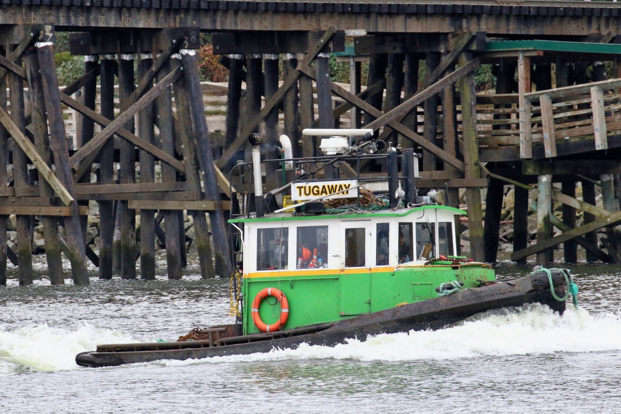 "Quality Towing Ltd. tugboat ""TUGAWAY"" at Queensborough Railway Bridge in the North Arm of Fraser River"