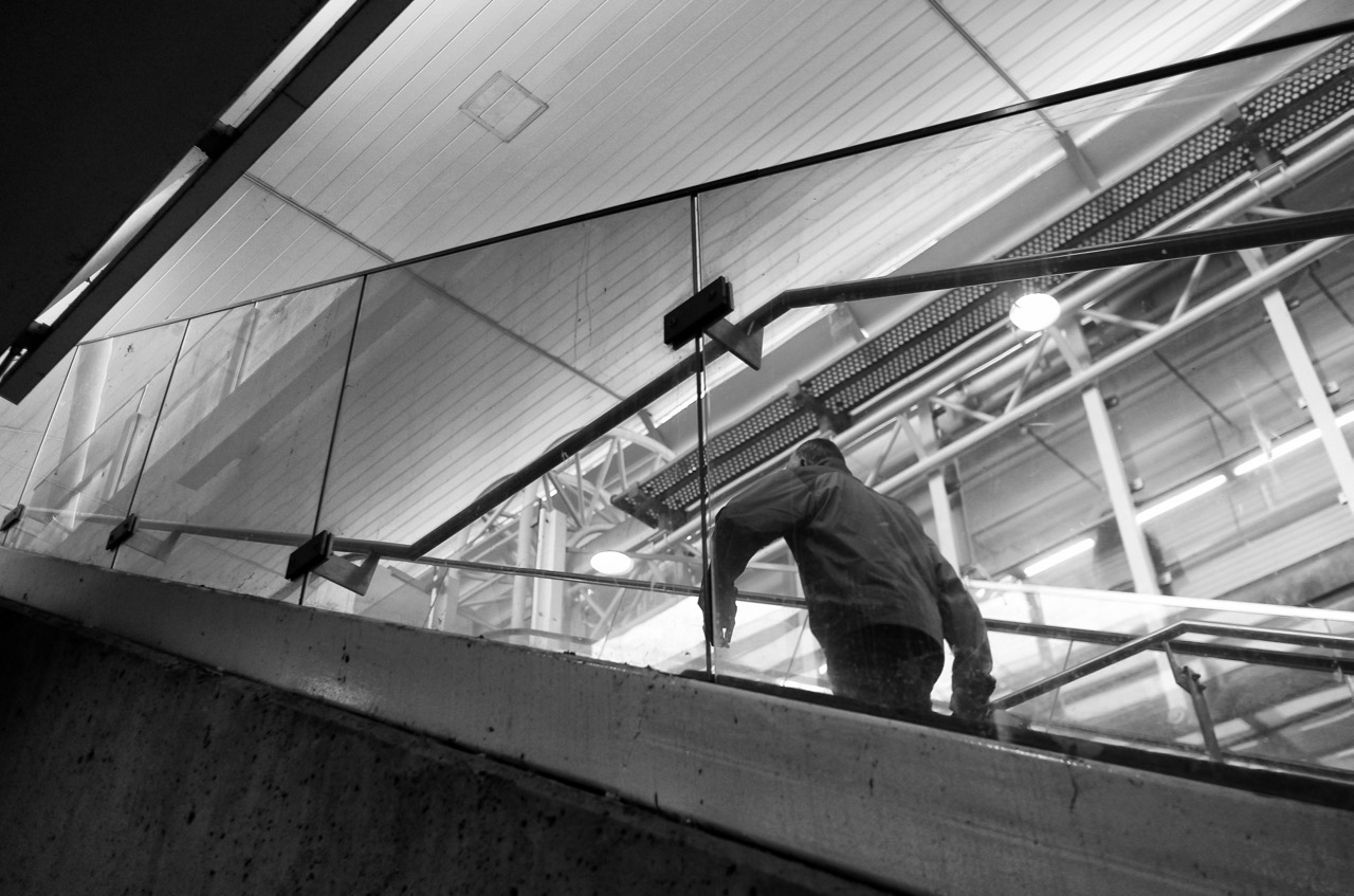 Man ascends at SkyTrain station, New Westminster, B.C.