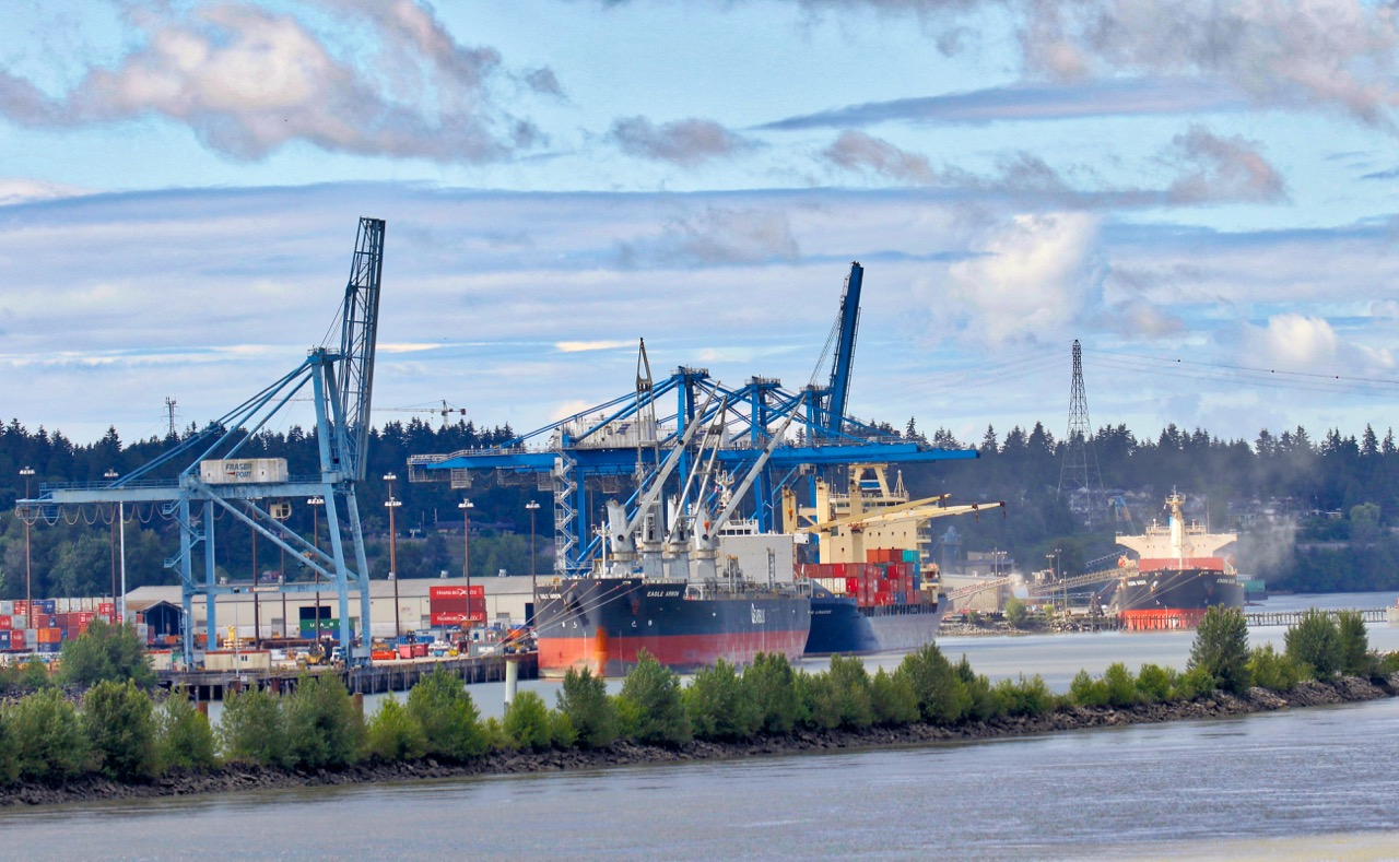 Fraser Surrey Docks is a marine terminal of Port of Vancouver. The cargo ships are (left to right): Eagle Arrow, BSL Limassol and Atacama Queen.