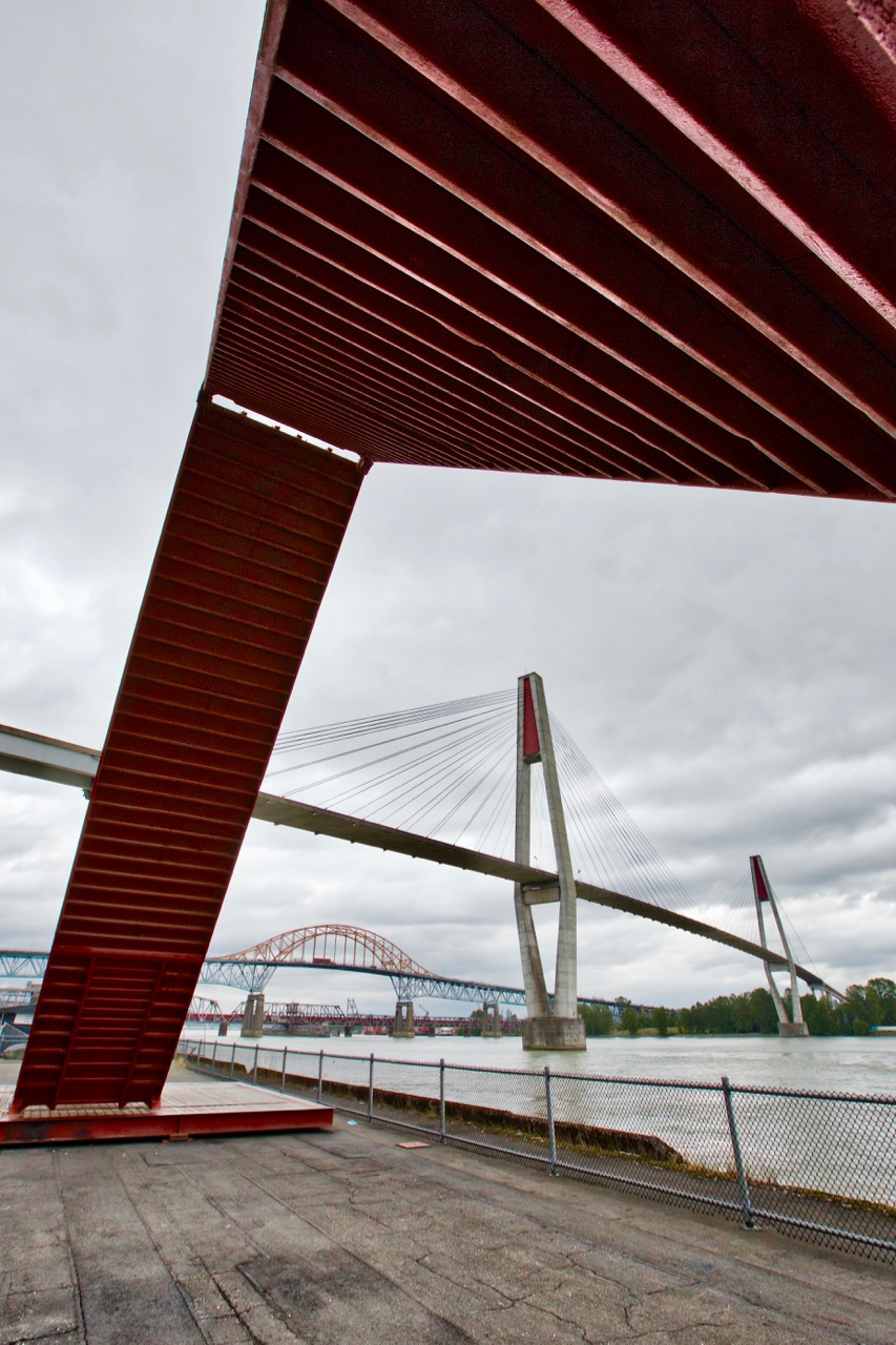 Shipping containers public art frame SkyBridge, Pattullo and Raiway bridges, Fraser River, New Westminster, B.C.