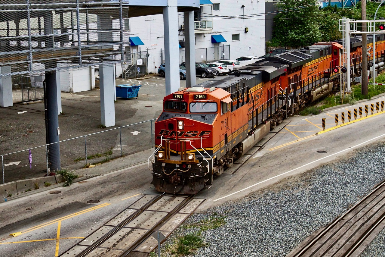 Burlington Northern Santa Fe Railway Co. (BNSF) locomotive 7161 crosses street, New Westminster, B.C.  BNSF is the largest freight railroad network in North America. Its headquarters is in  Fort Worth, Texas.