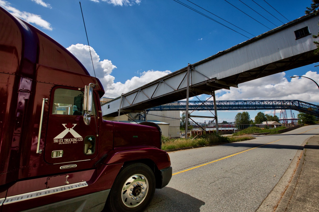 Freightliner transport truck passes by Kruger Products New Westminster Mill.  See our  Kruger Products feature  for more industrial photos.