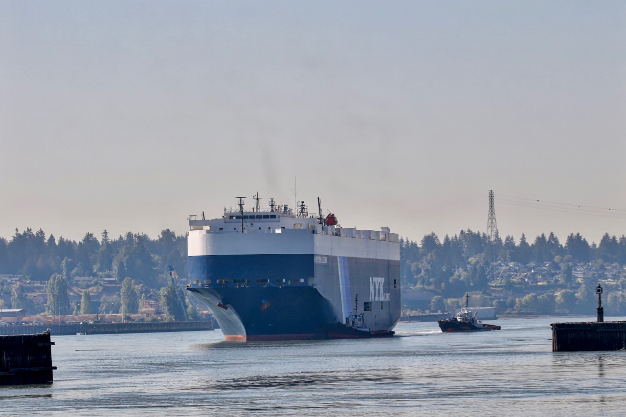 "Vehicles carrier cargo ship ""KARIYUSHI LEADER"" arrives at Annacis Auto Terminal in the Port of Vancouver assisted by Samson Tug Boats ""SHUSWAP"" and ""KOOTENAY."""